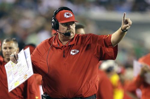 Kansas City Chiefs head coach Andy Reid calls a play during the second half of an NFL football game against the Philadelphia Eagles, Thursday, Sept. 19, 2013, in Philadelphia. (AP Photo/Matt Rourke)