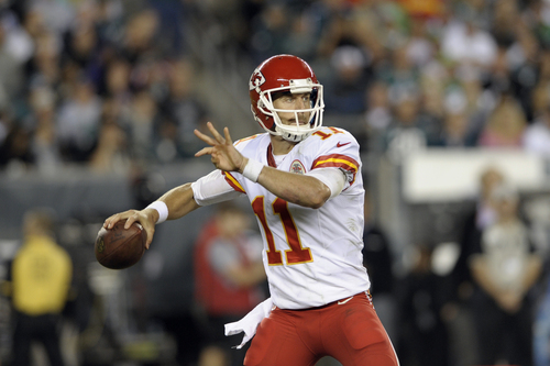 Kansas City Chiefs' Alex Smith in action during the second half of an NFL football game against the Philadelphia Eagles, Thursday, Sept. 19, 2013, in Philadelphia. (AP Photo/Michael Perez)