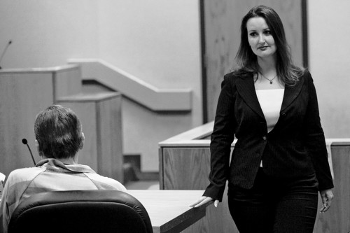 Mark Johnston | Daily Herald  Witness Gypsy Willis passes defendant Martin MacNeill after taking the witness stand during a preliminary hearing at the Fourth District Court in Provo Wednesday, Oct. 10, 2012.