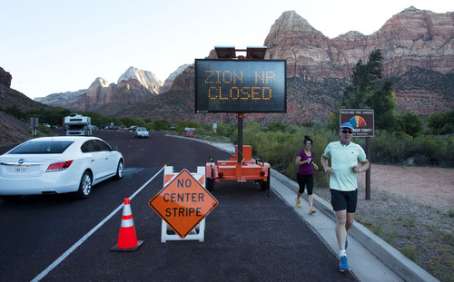 Steve Griffin  |  The Salt Lake Tribune A sign tells visitors to Zion National Park that the park is closed due to the federal government shutdown Tuesday October 1, 2013. Gov. Gary Herbert is asking President Obama to let the state operate Utah's national parks during the shutdown, saying their closure is hurting the economy.