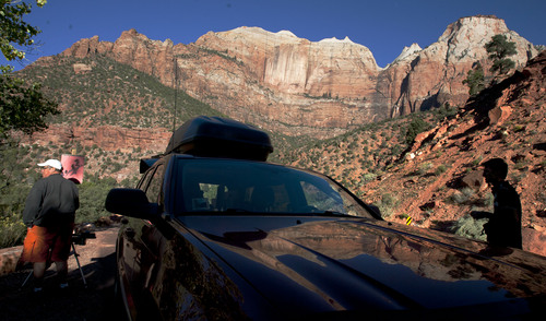 Steve Griffin  |  The Salt Lake Tribune  Mark Akins, of Littleton, Colo., paints, in the morning light, from the side of Highway 9 on Tuesday October 1, 2013. Zion National Park was in the process of shutting down due to the federal government shutdown.