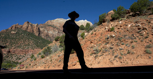 Steve Griffin  |  The Salt Lake Tribune  Cindy Purcell, chief park ranger at Zion National Park, walks back to her car on Highway 9 inside the park after telling visitors that the park is closed and there is no stopping on the side of the road to take photographs. The park closed due to the federal government shutdown Tuesday, October 1, 2013.