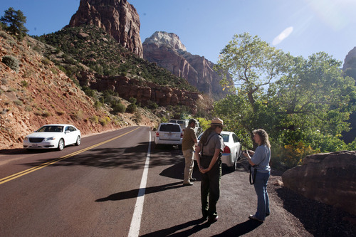 Steve Griffin  |  The Salt Lake Tribune  Cindy Purcell, chief park ranger at Zion National Park, informs visitors on Highway 9 inside the park that the park is closed and there is no stopping on the side of the road to take photographs. The park closed due to the federal government shutdown Tuesday, October 1, 2013.