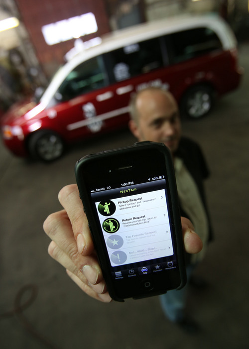 Francisco Kjolseth  |  The Salt Lake Tribune Michael Norvell, a dispatch manager at Ute Cab in Salt Lake City shows off a relatively new mobile app called nextaxi that the company has been using for its customers to hail a cab, track it and pay for the ride through the app.