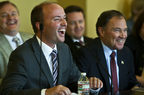Chris Detrick  |  The Salt Lake Tribune Utah Gov. Gary Herbert and Rep. Spencer Cox laugh during the confirmation hearing at the state Capitol Tuesday, Oct. 15, 2013, for Cox, who has been nominated by Herbert for lieutenant governor.