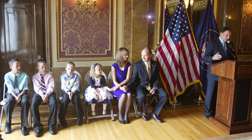 Keith Johnson | The Salt Lake Tribune   Utah Rep. Spencer J. Cox, R, Fairview sits with his wife Abby and their four children as Utah Gov. Gary Herbert announces his nomination of Cox for Lt. Governor, October 8, 2013 in Salt Lake City.