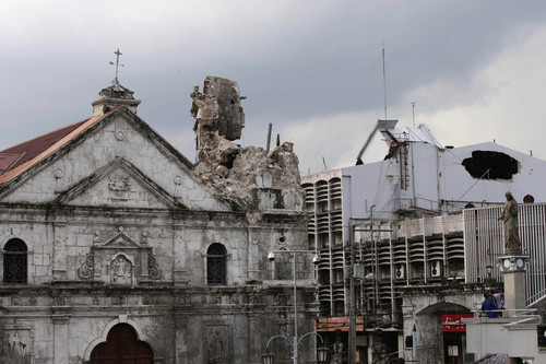 The Basilica De Sto. Nino (Basilica of the Holy Child) is seen with its bell tower gone following a 7.2-magnitude earthquake that hit Cebu city in central Philippines Tuesday Oct. 15, 2013. The tremor collapsed buildings, cracked roads and toppled the bell tower of the Philippines' oldest church Tuesday morning, causing multiple deaths across the central region and sending terrified residents into deadly stampedes .(AP Photo/Bullit Marquez)