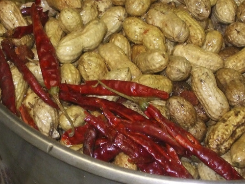 Kathy Stephenson | The Salt Lake Tribune North Carolina peanuts are combined with dried red peppers and spices for Chris and Dave's Cajun flavored boiled peanuts.