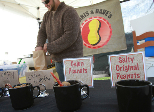 Keith Johnson | The Salt Lake Tribune   Dave Mathison sells his boiled peanuts at his Chris and Dave's stand at the farmer's market at Pioneer Park in Salt Lake City, October 12, 2013.