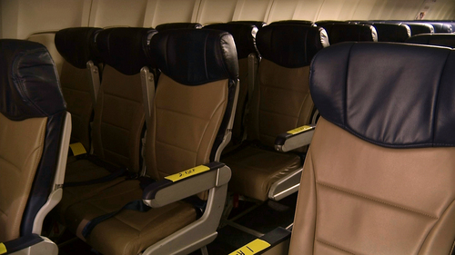 In this Sept. 23, 2013 photo, rows of slimline seats await installation onboard a Southwest Airlines 737 at the carrier's headquarters in Dallas. Southwest says passengers will have the same amount of legroom even though the new seats allow for another row onboard. (AP Photo/John Mone)