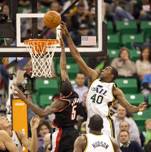 Lennie Mahler  |  The Salt Lake Tribune Jeremy Evans blocks a shot by Portland's Will Barton as the Jazz face the Blazers at EnergySolutions Arena on Wednesday, Oct. 16, 2013.