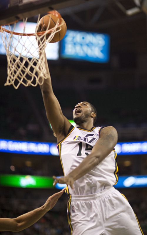 Lennie Mahler  |  The Salt Lake Tribune Derrick Favors lays the ball in for two points as the Utah Jazz faced the Portland Trailblazers at EnergySolutions Arena on Wednesday, Oct. 16, 2013. Portland beat Utah 99-92.