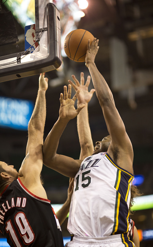 Lennie Mahler  |  The Salt Lake Tribune Derrick Favors shoots over Portland's Joel Freeland as the Utah Jazz face the Portland Trailblazers at EnergySolutions Arena on Wednesday, Oct. 16, 2013. Portland beat Utah 99-92.