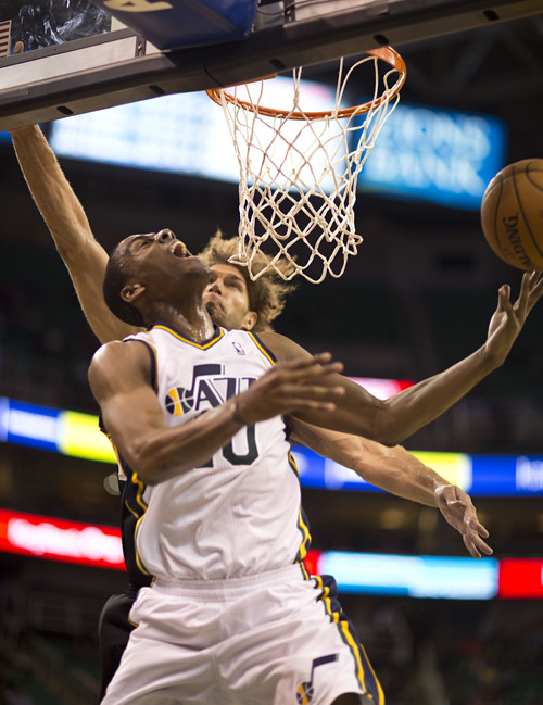 Lennie Mahler  |  The Salt Lake Tribune Alec Burks draws a foul from Portland's Robin Lopez as the Utah Jazz face the Portland Trailblazers at EnergySolutions Arena on Wednesday, Oct. 16, 2013. Portland beat Utah 99-92.