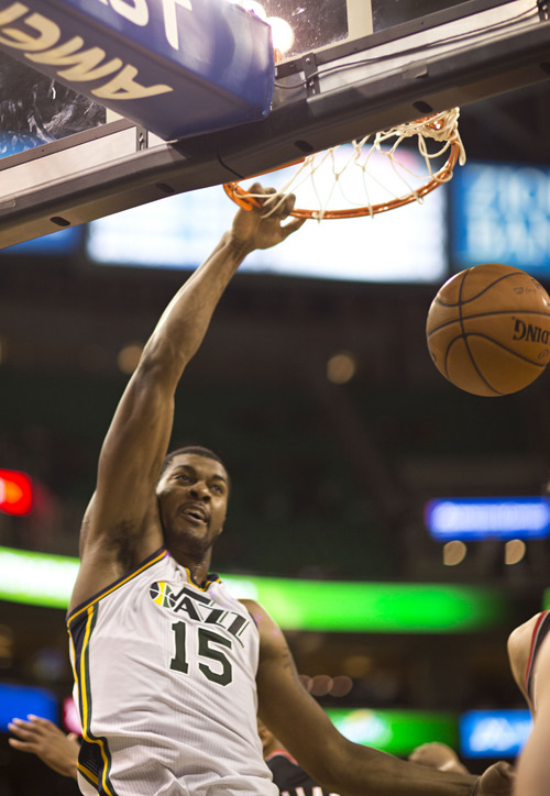 Lennie Mahler  |  The Salt Lake Tribune Derrick Favors dunks the ball as the Utah Jazz face the Portland Trailblazers at EnergySolutions Arena on Wednesday, Oct. 16, 2013. Portland beat Utah 99-92.