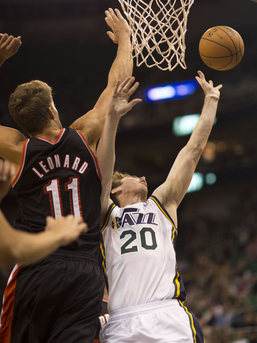 Lennie Mahler  |  The Salt Lake Tribune Gordon Hayward drives to the basket against Portland's Meyers Leonard as the Jazz face the Blazers at EnergySolutions Arena on Wednesday, Oct. 16, 2013.