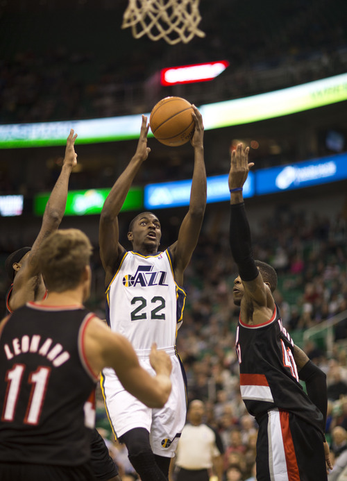 Lennie Mahler  |  The Salt Lake Tribune Justin Holiday drives to the hoop as the Jazz face the Blazers at EnergySolutions Arena on Wednesday, Oct. 16, 2013.