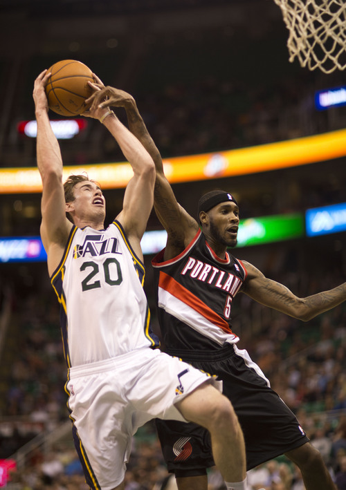 Lennie Mahler  |  The Salt Lake Tribune Gordon Hayward draws a foul and scores past Portland's Will Barton as the Jazz face the Blazers at EnergySolutions Arena on Wednesday, Oct. 16, 2013.