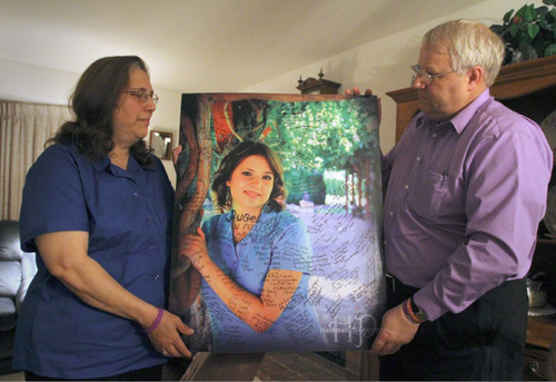 Rick Egan   |  The Salt Lake Tribune  Judy and Chuck Cox, the parents of Susan Cox Powell, hold a photo of their daughter during an interview in their home in Puyallup, Wash.
