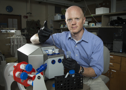 Courtesy of Brigham Young University BYU biologist Dr. Benjamin Bikman says a tiny lipid called ceramide is at the root of the pathway that disrupts our metabolism and leads to obesity.  Ph.D. student Melissa Smith.