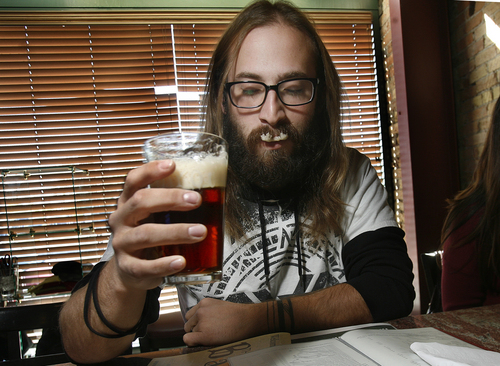 "Scott Sommerdorf   |  The Salt Lake Tribune Clay Turnbow savors a sip of the Uinta Bristlecone Brown Ale that was on tap at the Bayou during ""Firkin Friday"", Friday October 11, 2013. This British beer tradition involves smaller kegs of cask-conditioned beers that have been supplemented with unique ingredients like fresh hops, coffee or fruit."