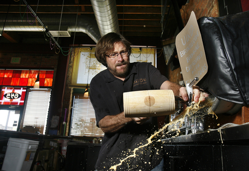 Scott Sommerdorf   |  The Salt Lake Tribune Bayou owner Mark Alston taps the keg of Uinta Bristlecone Brown Ale for Firkin Friday at The Bayou, Friday, October 11, 2013. This British beer tradition involves smaller kegs of cask-conditioned beers that have been supplemented with unique ingredients like fresh hops, coffee or fruit.