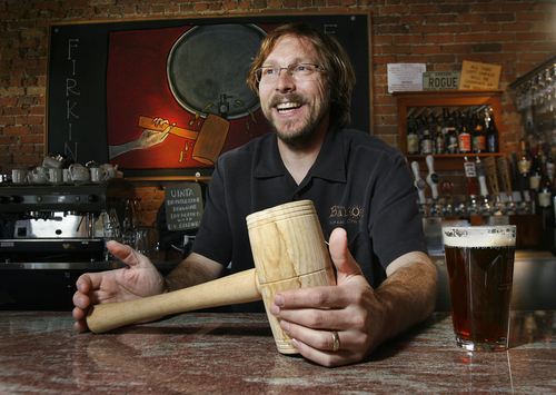 Scott Sommerdorf   |  The Salt Lake Tribune Bayou owner Mark Alston holds the mallet he used to tap the keg of Uinta Bristlecone Brown Ale that was being poured for Firkin Friday, Friday, October 11, 2013. This British beer tradition involves smaller kegs of cask-conditioned beers that have been supplemented with unique ingredients like fresh hops, coffee or fruit.