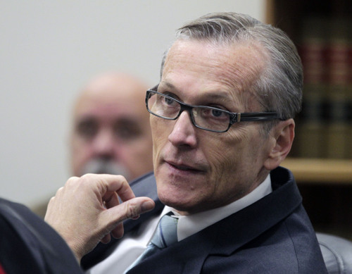 Al Hartmann  |  The Salt Lake Tribune Pleasant Grove physician Martin MacNeill, charged with murder for allegedly killing his wife, Michele MacNeill, in 2007 so he could continue an extra-marital affair appears in  Judge Derek Pullan's 4th District Court in Provo Thursday October 17.