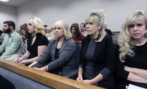 Al Hartmann  |  The Salt Lake Tribune Family members of Michele McNeill listen to testimony in Judge Derek Pullan's 4th District Court in Provo Thursday October 17 during the murder trial of Pleasant Grove physician Martin MacNeill. Martin McNeill is charged with murder and obstruction for allegedly killing his wife, Michele MacNeill in 2007 so he could continue an extra-marital affair.