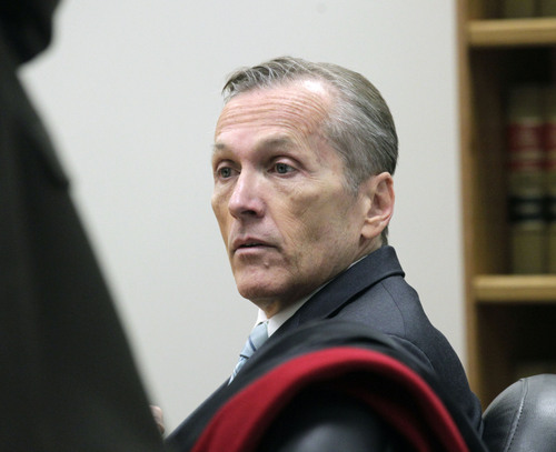 Al Hartmann  |  The Salt Lake Tribune Pleasant Grove physician Martin MacNeill, charged with murder for allegedly killing his killing his wife, Michele MacNeill, in 2007 so he could continue an extra-marital affair appears in  Judge Derek Pullan's 4th District Court in Provo Thursday October 17.