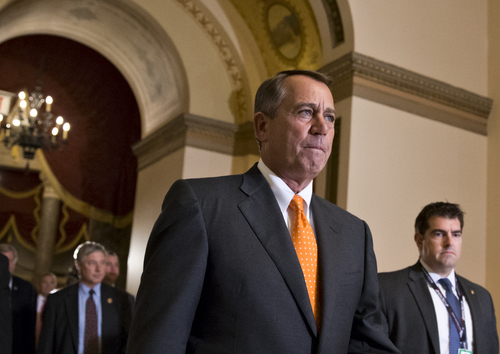 Speaker of the House John Boehner, R-Ohio, walks to the chamber for the vote on a Senate-passed bill that would avert a threatened Treasury default and reopen the government after a partial, 16-day shutdown, at the Capitol in Washington, Wednesday, Oct. 16, 2013. The end to the rancorous standoff between the Democratic-controlled Senate and the Republican-controlled House was hastened by the imminent deadline to extend the debt ceiling to avoid a national default. (AP Photo/J. Scott Applewhite)