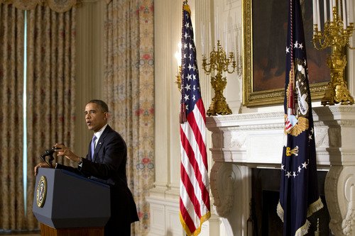 President Barack Obama speaks in the State Dining Room of the White House in Washington on Thursday, Oct. 17, 2013. Lawmakers Wednesday voted to avoid a financial default and reopen the government after a 16-day partial shutdown. (AP Photo/Jacquelyn Martin)