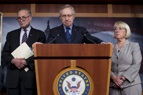 AP10ThingsToSee - Senate Majority Leader Sen. Harry Reid, D-Nev., center, pauses during a news conference with Sen. Chuck Schumer, D-N.Y., left, Sen. Dick Durbin, D-Ill., (not shown) and Sen. Patty Muray, D-Wash., right, during on Capitol Hill on Saturday, Oct. 12, 2013 in Washington. The federal government remains partially shut down and faces a first-ever default between Oct. 17 and the end of the month. (AP Photo/ Evan Vucci, File)