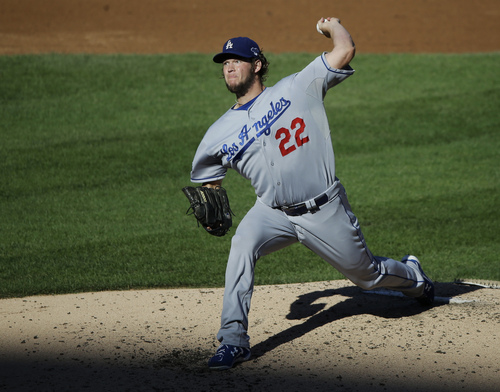 Los Angeles Dodgers starting pitcher Clayton Kershaw throws during the second inning of Game 2 of the National League baseball championship series against the St. Louis Cardinals Saturday, Oct. 12, 2013, in St. Louis. (AP Photo/Charlie Neibergall)