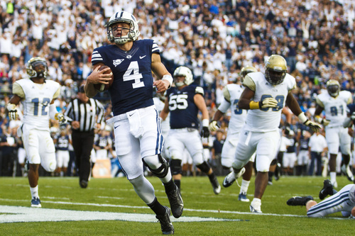 Brigham Young quarterback Taysom Hill (4) runs the ball during an NCAA college football game Saturday, Oct. 12, 2013 at  in Provo, Utah. (AP Photo/The Daily Herald, Alex Goodlett)