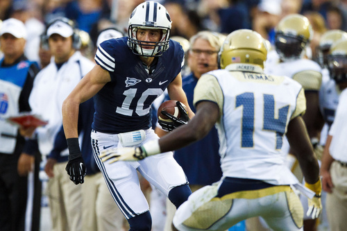 Brigham Young Cougars wide receiver Mitch Mathews (10) looks to run around Georgia Tech's Jemea Thomas (14) during an NCAA college football game Saturday, Oct. 12, 2013 in Provo, Utah. (AP Photo/The Daily Herald, Alex Goodlett)