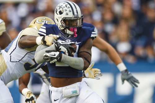 Brigham Young running back Jamaal Williams (21) dodges a tackle during an NCAA college football game Saturday, Oct. 12, 2013 at  in Provo, Utah. (AP Photo/The Daily Herald, Alex Goodlett)