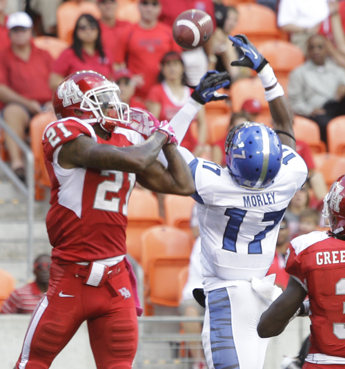 Memphis' Chris Morley, right, breaks up pass intended for Houston' Markeith Ambles, left, during the second quarter of an NCAA college football game at BBVA Compass Stadium Saturday, Oct. 12, 2013, in Houston.  (AP Photo/Houston Chronicle, Melissa Phillip)