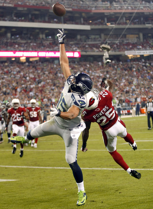 Seattle Seahawks wide receiver Jermaine Kearse (15) can't make the catch as Arizona Cardinals cornerback Jerraud Powers (25) defends during the second half of an NFL football game, Thursday, Oct. 17, 2013, in Glendale, Ariz. (AP Photo/Rick Scuteri)