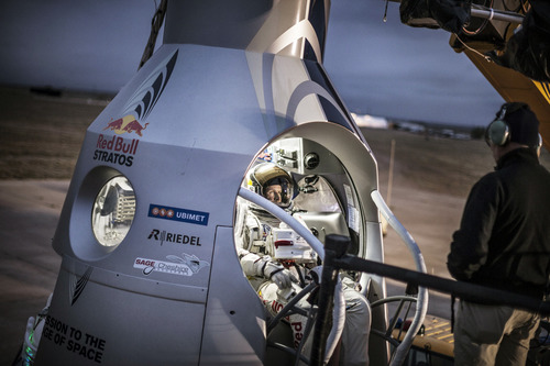 In a photo provided by Red Bull, pilot Felix Baumgartner of Austria,sits in his capsule during the preparation for the final manned flight of Red Bull Stratos in Roswell, N.M. on Saturday, Oct. 6, 2012.  Red Bull Stratos announced Friday that the jump by extreme athlete Baumgartner have been moved from Monday to Tuesday, Oct. 9,  due to a cold front with gusty winds. The jump can only be made if winds on the ground are under 2 mph for the initial launch a balloon carrying Baumgartner. (AP Photo/Red Bull, Joerg Mitter)