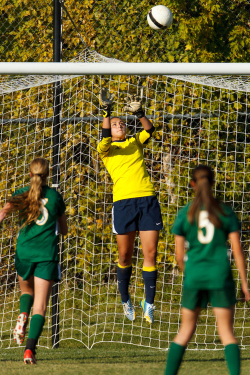 Trent Nelson  |  The Salt Lake Tribune Skyline goalkeeper Hillary Weixler makes a save as Skyline hosts Clearfield High School, girls soccer 4A state quarterfinal in Salt Lake City, Thursday October 17, 2013.