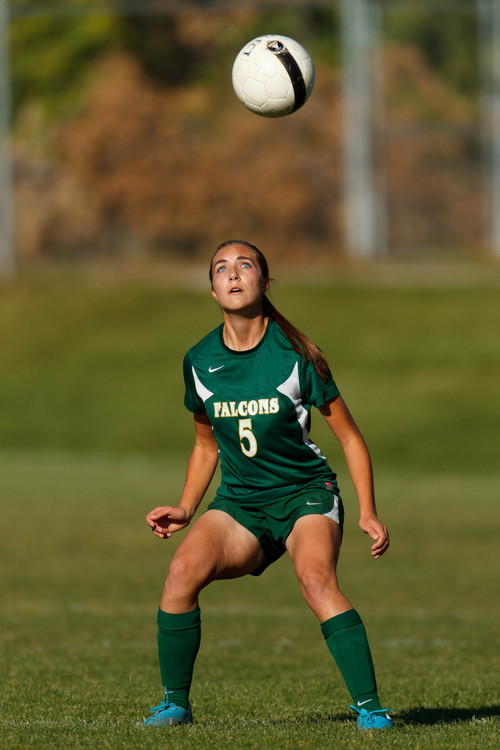 Trent Nelson     The Salt Lake Tribune Clearfield's Ellie Penner heads the ball as Skyline hosts Clearfield High School, girls soccer 4A state quarterfinal in Salt Lake City, Thursday October 17, 2013.
