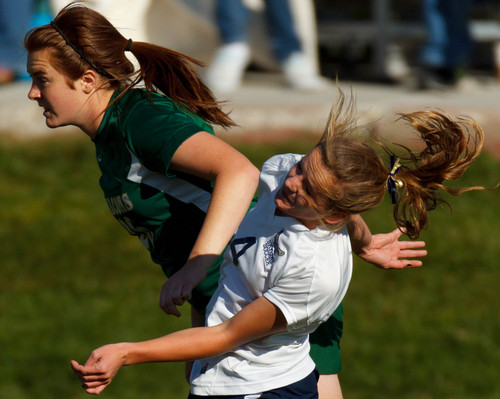 Trent Nelson     The Salt Lake Tribune Clearfield's Lexi Taylor tangles with Skyline's Emma Heyn as Skyline hosts Clearfield High School, girls soccer 4A state quarterfinal in Salt Lake City, Thursday October 17, 2013.