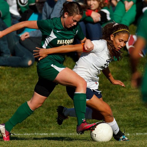 Trent Nelson     The Salt Lake Tribune Skyline's Jaslyn Masina works the ball with Clearfield's Kristen Strawn defending as Skyline hosts Clearfield High School, girls soccer 4A state quarterfinal in Salt Lake City, Thursday October 17, 2013.