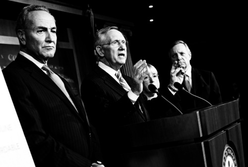 Senate Majority Leader Sen. Harry Reid, D-Nev., gestures during a news conference with, from left, Sen. Chuck Schumer, D-N.Y., Sen. Patty Murray, D-Wash., and Sen. Dick Durbin, D-Ill., after passing a bill to raise the debt ceiling and fund the government on Capitol Hill on Wednesday, Oct. 16, 2013 in Washington. (AP Photo/ Evan Vucci)