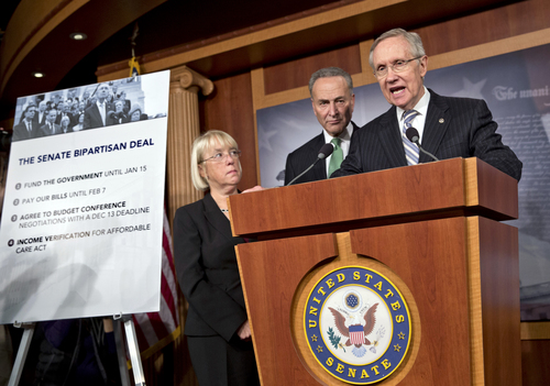 Senate Majority Leader Harry Reid, D-Nev., speaks with reporters after voting on a measure to avert a threatened Treasury default and reopen the government after a partial, 16-day shutdown, at the Capitol in Washington, Wednesday, Oct. 16, 2013, as Sen. Patty Murray, D-Wash., chair of the Senate Budget Committee, Sen. Chuck Schumer, D-N.Y., listen.  (AP Photo/J. Scott Applewhite)