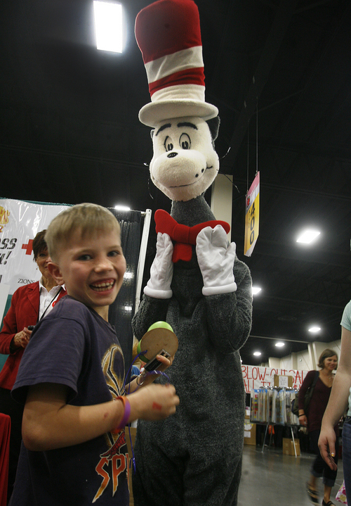 "Scott Sommerdorf  |  The Salt Lake Tribune Ian Prescott is happy to meet ""The Cat in the Hat"" who was roaming the floor during the two-day UEA convention at South Towne Exposition Center on Thursday."
