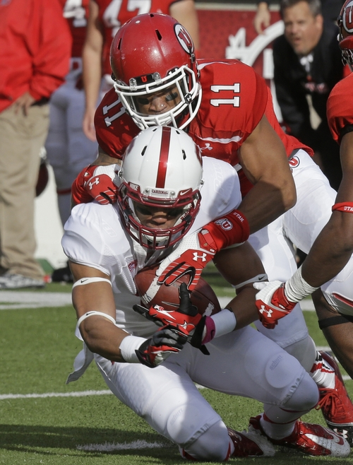 Stanford wide receiver Michael Rector, bottom, is tackled by Utah defensive back Davion Orphey (11) during the first quarter of an NCAA college football game on Saturday, Oct. 12, 2013, in Salt Lake City. (AP Photo/Rick Bowmer)