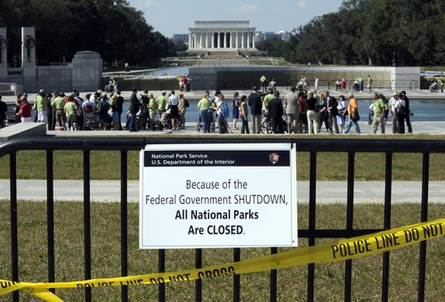 Susan Walsh  |  Associated Press file photo Despite signs stating that the national parks are closed, people visit the World War II Memorial in Washingtonin early October. The current budget standoff may be over, but opposition is regrouping for a possible next battle in January.