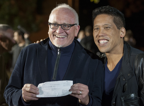 David Gibson,left,  and Rich Kiamco, right,  of Jersey City display their marriage license, which they obtained earlier today, during a rally on the lawn in front of Garden State Equality tonight, Friday Oct. 18, 2013, in Montclair, N.J.  The state Supreme Court ruled today that the state must begin granting same-sex marriage licenses. (AP Photo/Joe Epstein)